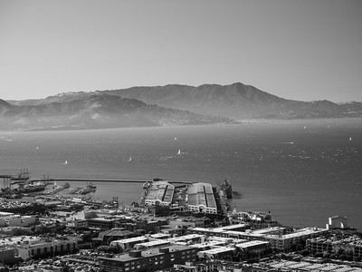 Foreground: Fishermans Wharf (center), Aquatic Park & Hyde Street Pier (left) In the distance: Golden Gate National Recreation Area (left), Sausalito, CA (center)  On top of Coit Tower. San Francisco, CA, USA