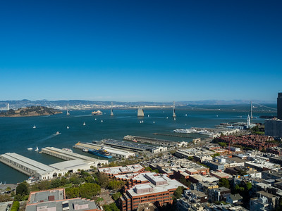 Piers (foreground), Bay Bridge (background), Yerba Buena Island  (left)  On top of Coit Tower. San Francisco, CA, USA