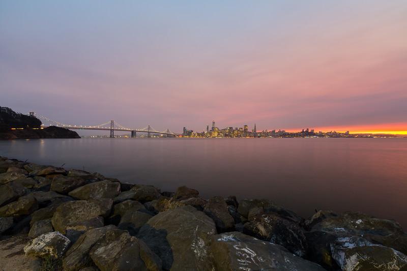 Smoke from fires burning in the San Francisco North Bay.<br /> <br /> Dusk. San Francisco & Golden Gate Bridge. Treasure Island, CA, USA