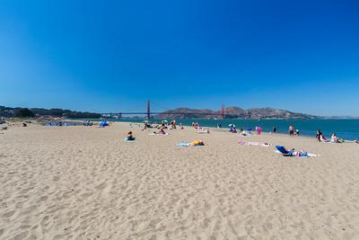 Golden Gate Bridge & Beach Goers. Crissy Field East Beach - San Francisco, CA, USA