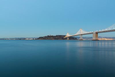 Dusk. Treasure Island, Yerba Buena Island, Bay Bridge. Pier 14 - San Francisco, CA, USA