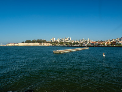 Fort Mason & Bay Bridge (left), and Downtown San Francisco. Near The Wave Organ. San Francisco, CA, USA
