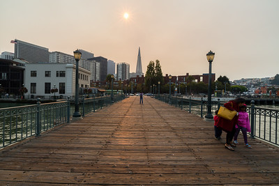 Smoke from fires burning in the San Francisco North Bay.  Transamerica Pyramid & The Embarcadero. Pier 7. San Francisco, CA, USA