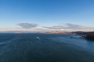 Sunset. Alcatraz Island (Left), San Francisco (Right). Golden Gate Bridge - San Francisco, CA, USA