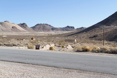 Miner's Union Hall (Front), Jailhouse (Right Back). Rhyolite Ghost Town - Rhyolite, NV
