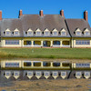 Whalehead Club is a historic shooting club located near Corolla, Currituck County, North Carolina. The clubhouse was built as a private hunting retreat on the grounds of the Lighthouse Club between 1922 and 1925. It consists of a three-story, five bay, central block flanked by lower blocks with screened in porches. All three blocks are capped by steep gable roofs with dormers. During World War II, the property was leased by the United States Coast Guard.[2]<br /> <br /> It was listed on the National Register of Historic Places in 1980.(Wikipedia)