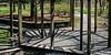 D108-2017<br /> Panorama of shadows in the Perennial Garden gazebo (from four portrait format singles).<br /> <br /> County Farm Park, Ann Arbor<br /> Taken April 18, 2017