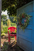 For 2017-07-29: Blue garden door with red chair - v.1, portrait format