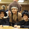 Sydney Morath, as St. Elizabeth Ann Seton, Marialena Ochoa, as Saint Kateri Tekakwitha, and Charlee Morath, as St. Josephine Bakhita, are all 10-year-old fifth graders at Notre Dame Catholic School in Wichita Falls and Sacred Heart parishioners who attended the All Hallow's Eve Celebration.