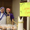 Vivian Wolf, co-chair of the Junior Catholic Daughters of America Court No. 309, who is dressed as Mother Teresa, and Lauren Morath, Sacred Heart member and JCDA mom volunteer, who is dressed as Saint Martha, sell caramel apples for the JCDA during the All Hallow's Eve Celebration at Sacred Heart Church in Wichita Falls on Oct. 29.