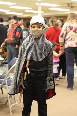 Mark Gorley, 8, models his Saint George costume during the dinner at the All Hallow's Eve celebration.