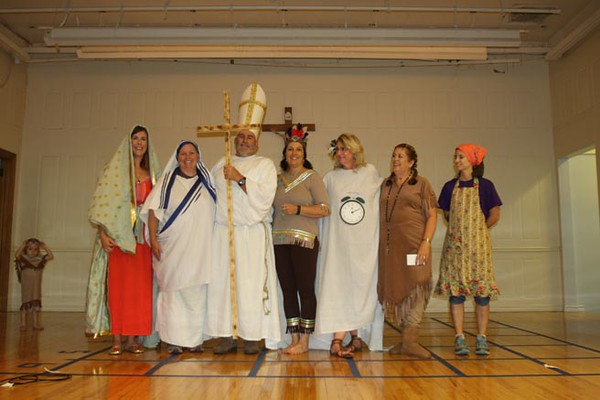 "In the adult division of the costume contest, Jenara Burgess entered as Our Lady of Guadalupe, Vivian Wolf entered as Saint Mother Teresa, her husband Danny Wolf entered as Saint Pope John Paul II, Daunne Peters entered as Saint Kateri Tekakwitha, Kathy Browning entered jokingly as ""Saint"" Tenafter (billed as patron saint of people who are late), Joene Kocks entered as Saint Kateria Tekakwitha, and Lauren Morath entered as Saint Martha."