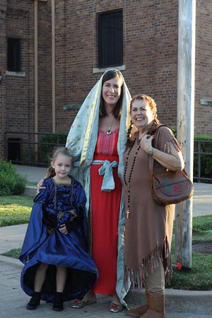 Gia Burgess, 5, dressed as Saint Catherine of Alexandria is shown with her mother, Jenara Burgess, who dressed as Our Lady of Guadalupe, and her grandmother Joene Kocks, who dressed as Saint Kateri Tekakwitha. Both women are longtime members of Sacred Heart Church in Wichita Falls.