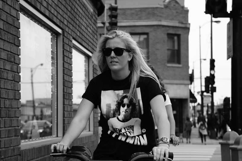 Lincoln Square black t-shirt on a bike