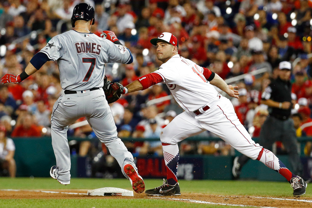 . Cincinnati Reds first baseman Joey Votto (19) takes out Cleveland Indians Yan Gomes (7) during the seventh inning at the Major League Baseball All-star Game, Tuesday, July 17, 2018 in Washington. (AP Photo/Patrick Semansky)