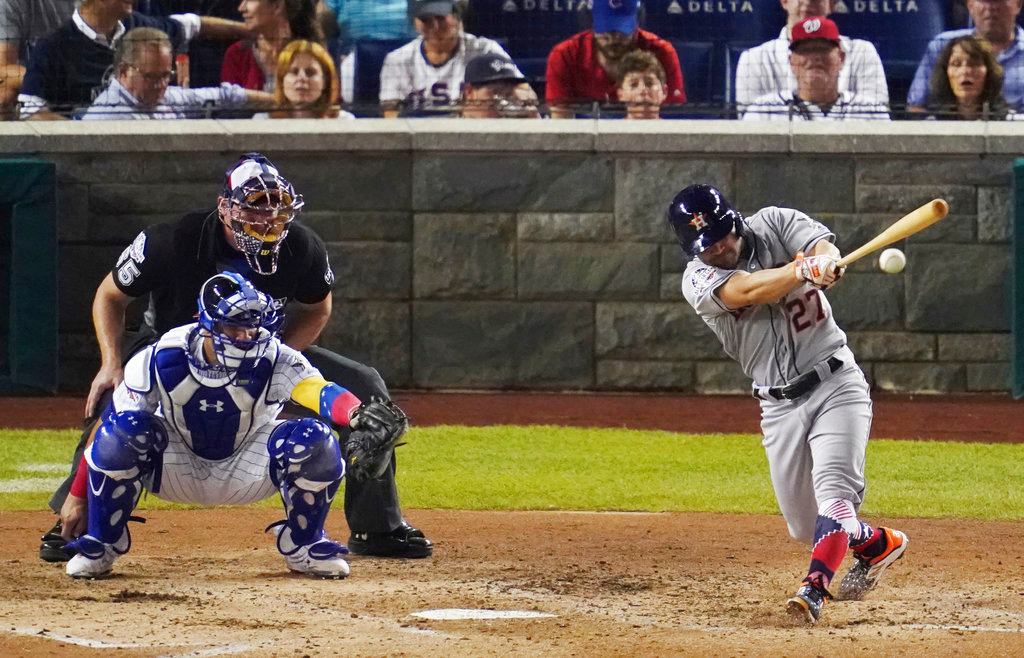 . Houston Astros Jose Altuve (27) hits a single in the fifth inning during the 89th MLB baseball All-Star Game, Tuesday, July 17, 2018, at Nationals Park, in Washington. (AP Photo/Carolyn Kaster)
