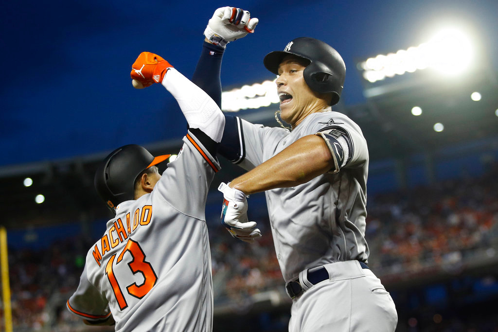 . New York Yankees outfielder Aaron Judge (99) celebrates his solo home run with Baltimore Orioles shortstop Manny Machado (13) during the first inning Major League Baseball All-star Game, Tuesday, July 17, 2018 in Washington. (AP Photo/Patrick Semansky)