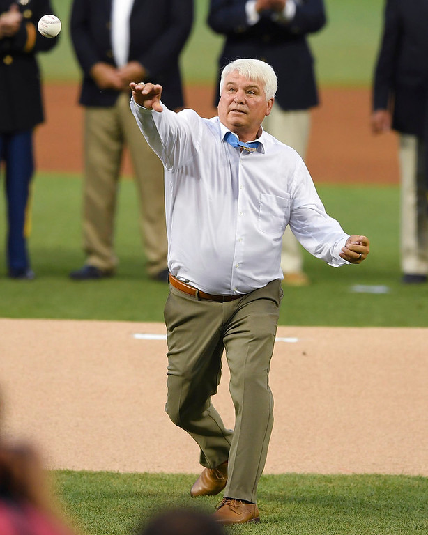 . Medal of Honor recipient James McCloughan throws the ceremonial first pitch during the Major League Baseball All-star Game, Tuesday, July 17, 2018 in Washington. (AP Photo/Nick Wass, Pool)
