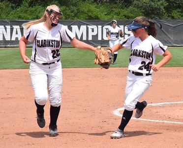 MATTHEW B. MOWERY/The Oakland Press file photo Clarkston's Olivia Warrington (left) is a Division I honorable mention on the Michigan High School Softball Coaches Association All-State team.