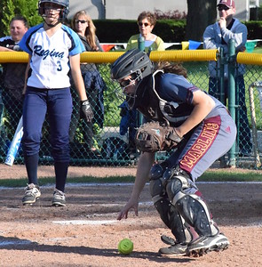 MATTHEW B. MOWERY/The Oakland Press file photo Farmington Hills Mercy's Anna Dixon (right) is a Division I honorable mention on the Michigan High School Softball Coaches Association All-State team.