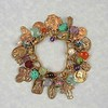 "0-GCRM-MLT CO169  15 BRONZE MEDALS WITH GEMSTONES AND CLOISONNE ON VINTAGE CHANEL CHAIN (CHAIN MAY BE DIFFERENT BUT SIMILAR)  WE MAKE AN EXTERNDER--9.5"" CO 35 WITH STONES AND BEADS TO ATTACH TO BRACELET SO IT CAN BE WORN AS A NECKLACE--GREAT SELLING POINT.  CHAIN VARIES BECAUSE WE SELL SO MANY OF THESE WE KEEP RUNNING OUT OF THE VINTAGE CHAIN.  THEY ARE ALL VERY SIMILAR."