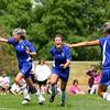 Soccer girls celebrate after crucial goal!