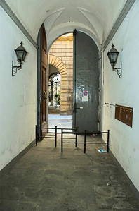 View of the back of the main door from  inside the building looking into Via dei Serragli street