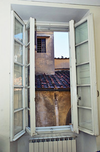 View from office studio looking a the the walls of the other apartments in the Palazzo