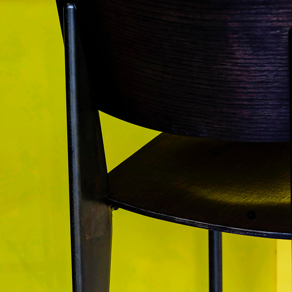 6570 Black Chair Yellow Wall