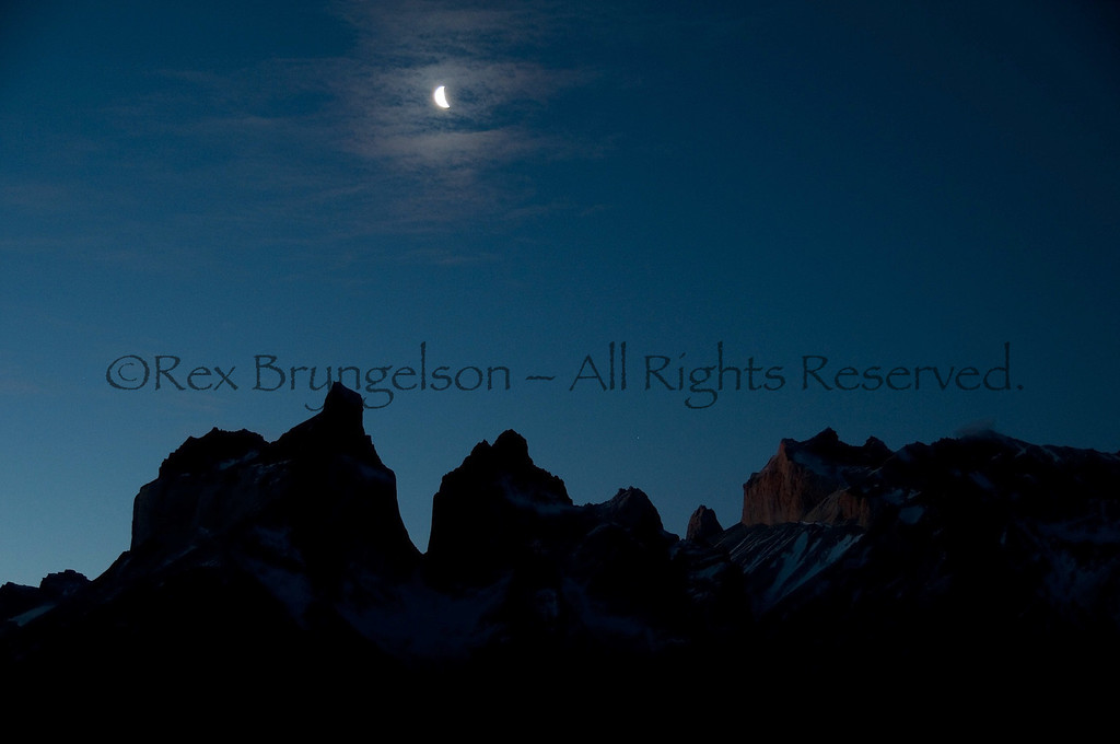 Moon over Los Cuernos. Torres del Paine National Park.