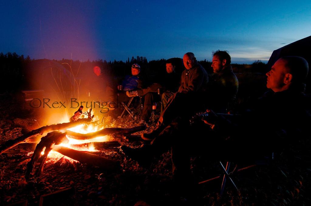 Serge Vitali entertains his French cohorts at camp on the Kisaralik River, Alaska