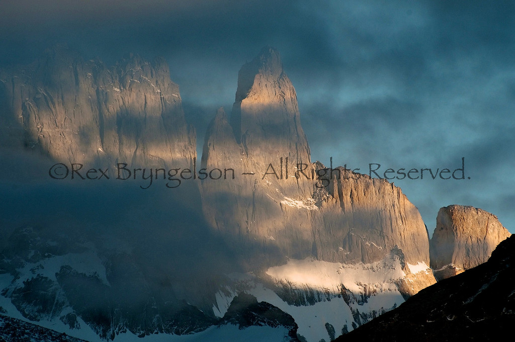 The clouds lift in front Cerro Espada at dawn. Torres del Paine National Park.