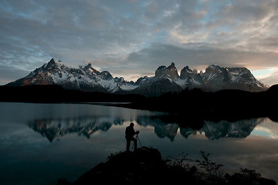 A photographer at dawn in Torres del Paine National Park. Chilean Patagonia.