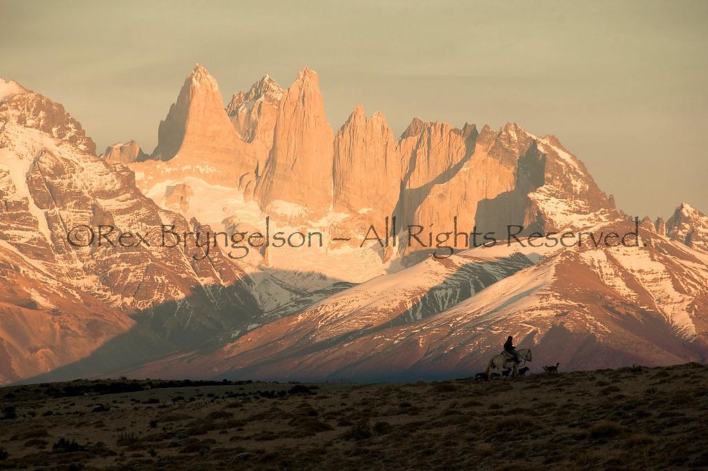 "A ""Baqueano"" rides out at dawn near Torres del Paine. Estancia Cerro Guido  Chilean Patagonia."
