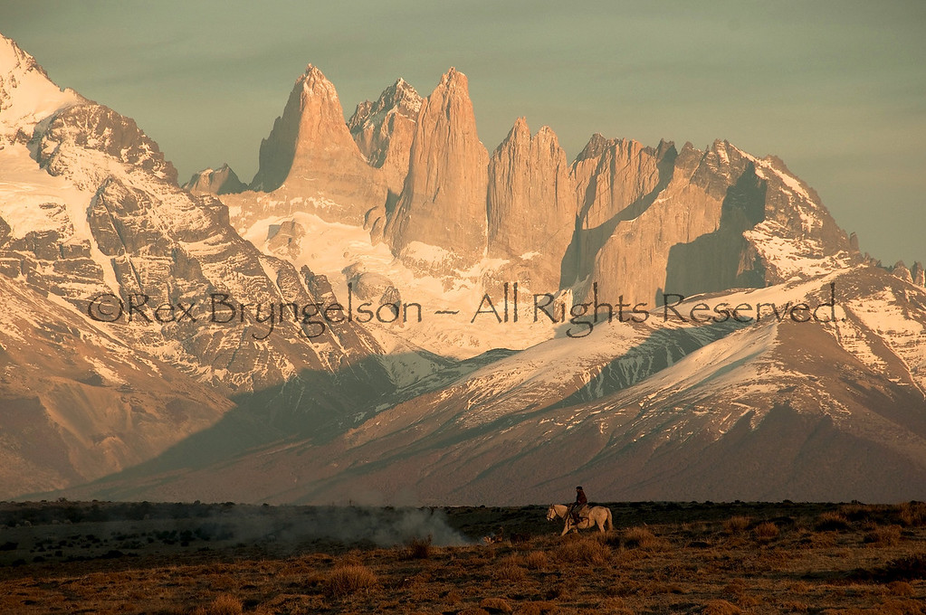 """A """"Baqueano"""" sends off a smoke signal to call in other hands. Estancia Cerro Guido  Chilean Patagonia."""