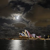 Sydney Opera House, under moonlit night.