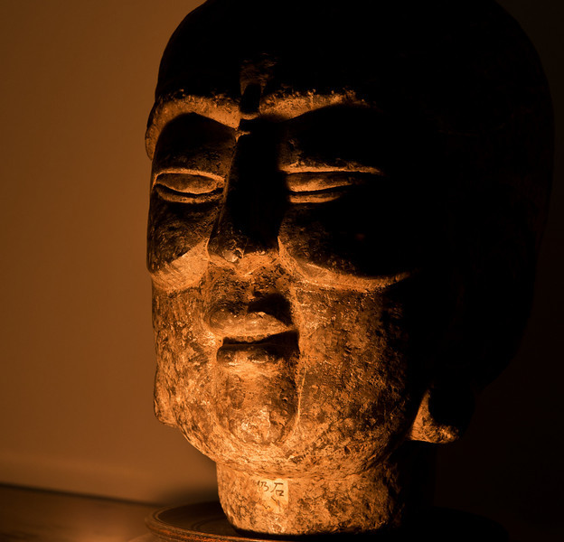 Old Granite Head, lit by candle.