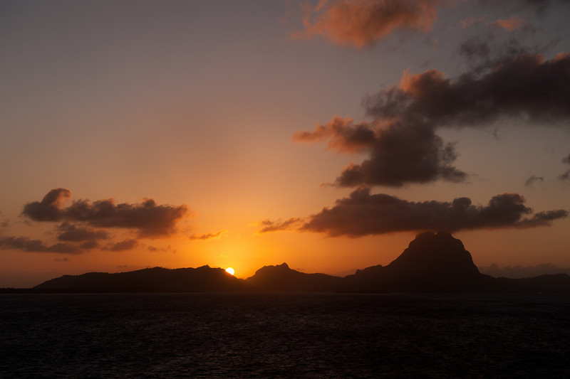 Sunrise over Bora Bora island in French Polynesia.<br /> September 2009 taken from the Sun Princess.