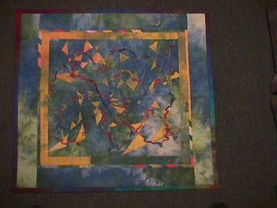 """A small quilt, """"Celebrate"""" started at a workshop with David Walker, at Rolduc, Belgium and exhibited at the NFWI Millennium Exhibition, Tatton Park, 2000"""