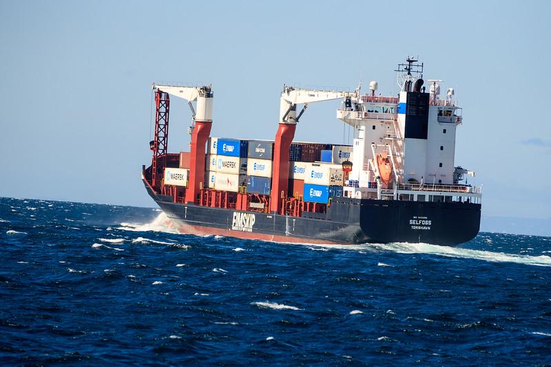 Freighter Ship Leaving Reykjavík