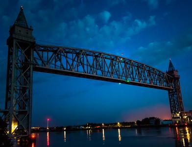Illuminated Old Glory (US flag) on the train bridge over the Cape Cod Canal
