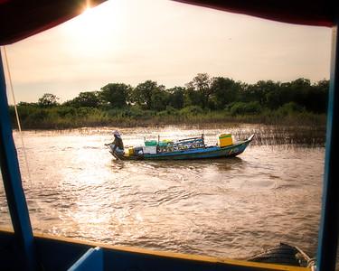 """Floating Village"" boat returning home at dusk - Siem Reap River, Cambodia"
