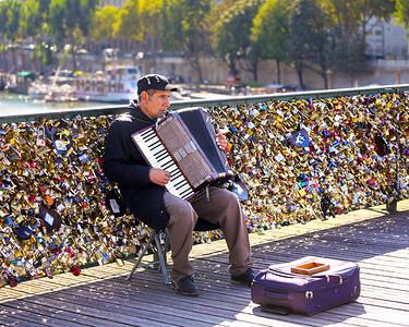 "Musician on the ""Lovers Brigde"" - Paris"