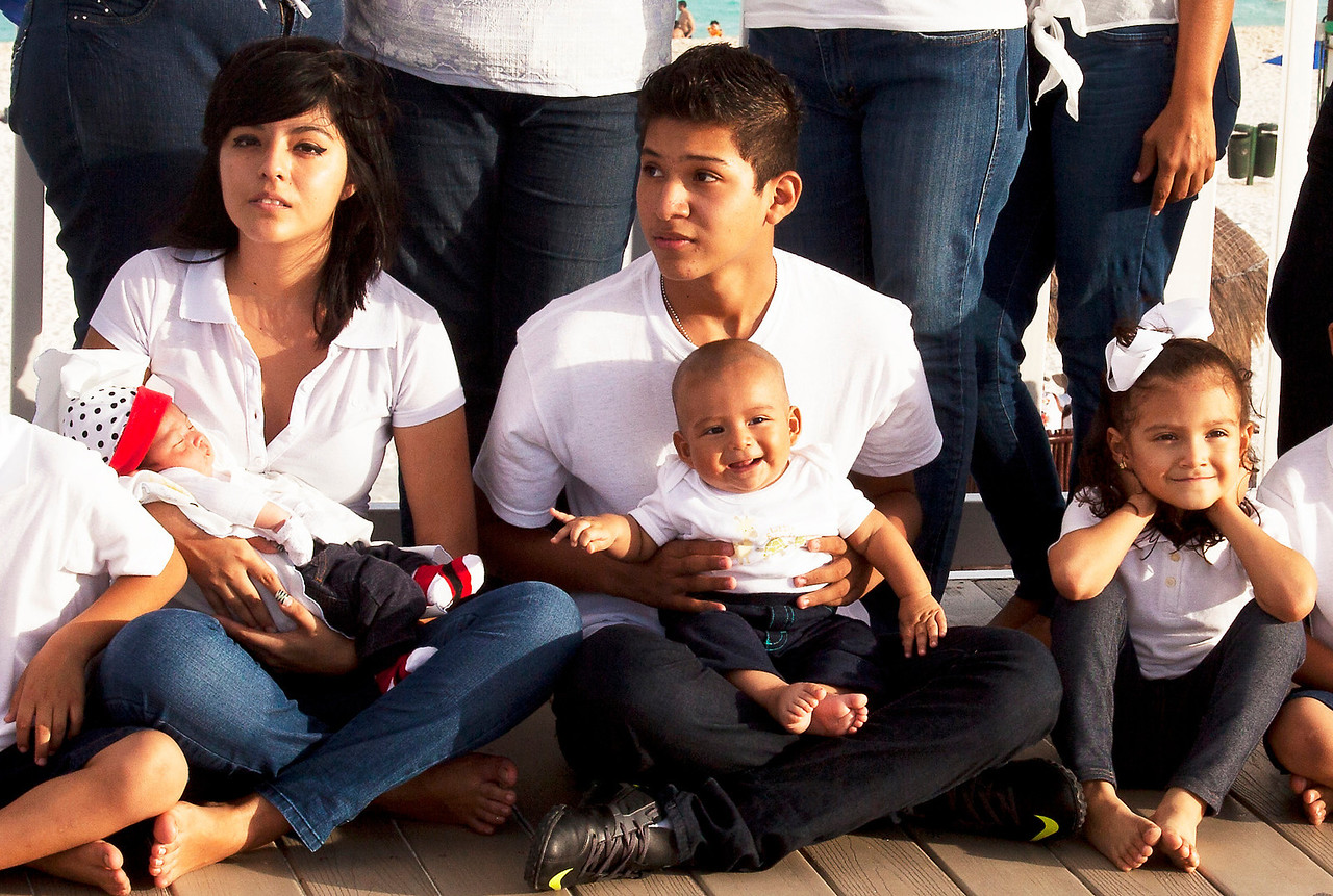Cancun Family Posing for Photograph with  Newborn