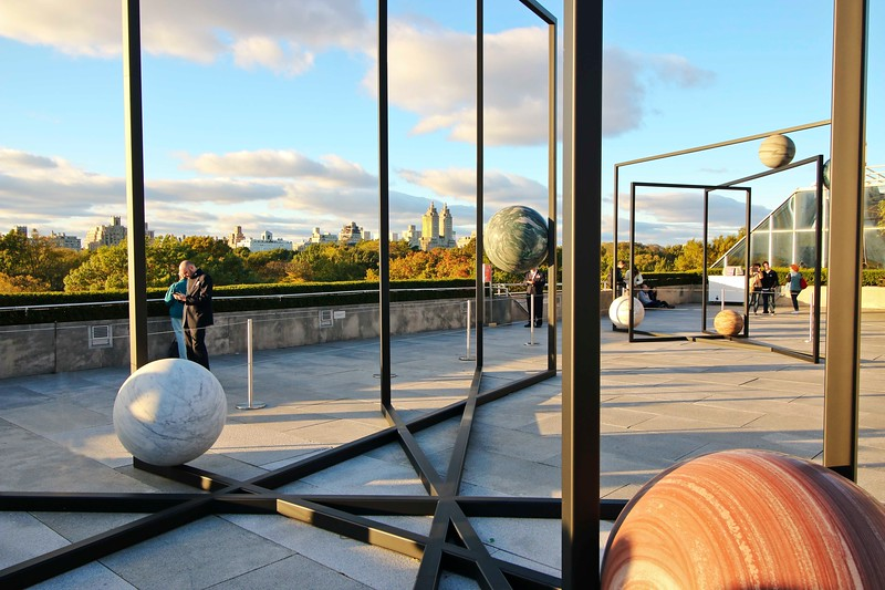 "Metropolitan Museum's Rooftop Exhibit  called ""Parapivot"" by Berlin-based artist Alicja Kwade, with view of Central  Park"