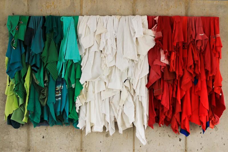 """Michelangelo Pistoletto's, """"Stracci italiani"""" (Italian Rags), a reinterpretation of the tricolor Italian flag made of discarded fabric."""