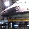 a space flown shuttle and a skytee for scale