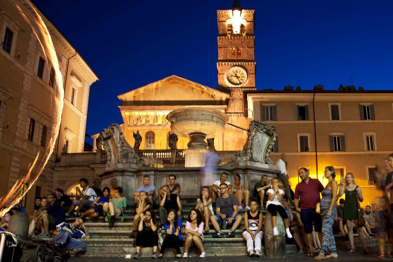 Watching Performer in Piazza of Santa Maria Church at Night, Trestavere