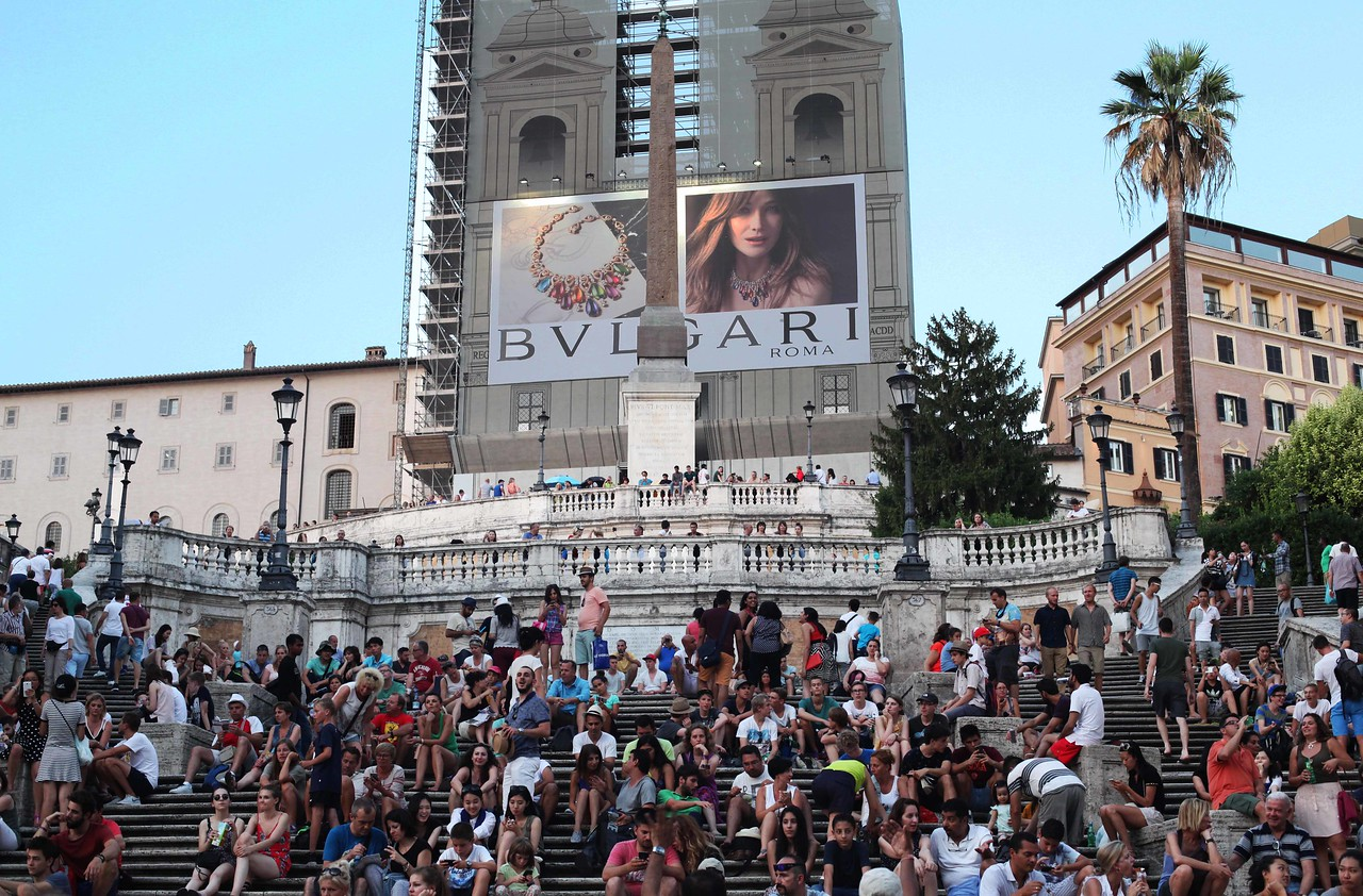 Spanish Steps, Church Under Construction, Advertising. When major sites are restored, Italian companies often pay part of the restoration costs in exchange for advertising.