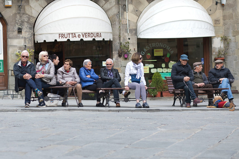 Women and Men Relaxing in Cortona, a Tuscan Hill Town